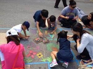 Chalk Walk features areas where attendees can create their own chalk art.